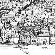A detail from a black-and-white map showing buildings crowded together along the edge of a river